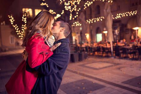 Young Affectionate Couple Kissing Tenderly On Christmas Street New Year Message For Boyfriend Happy New Year Message New Year Wishes Messages