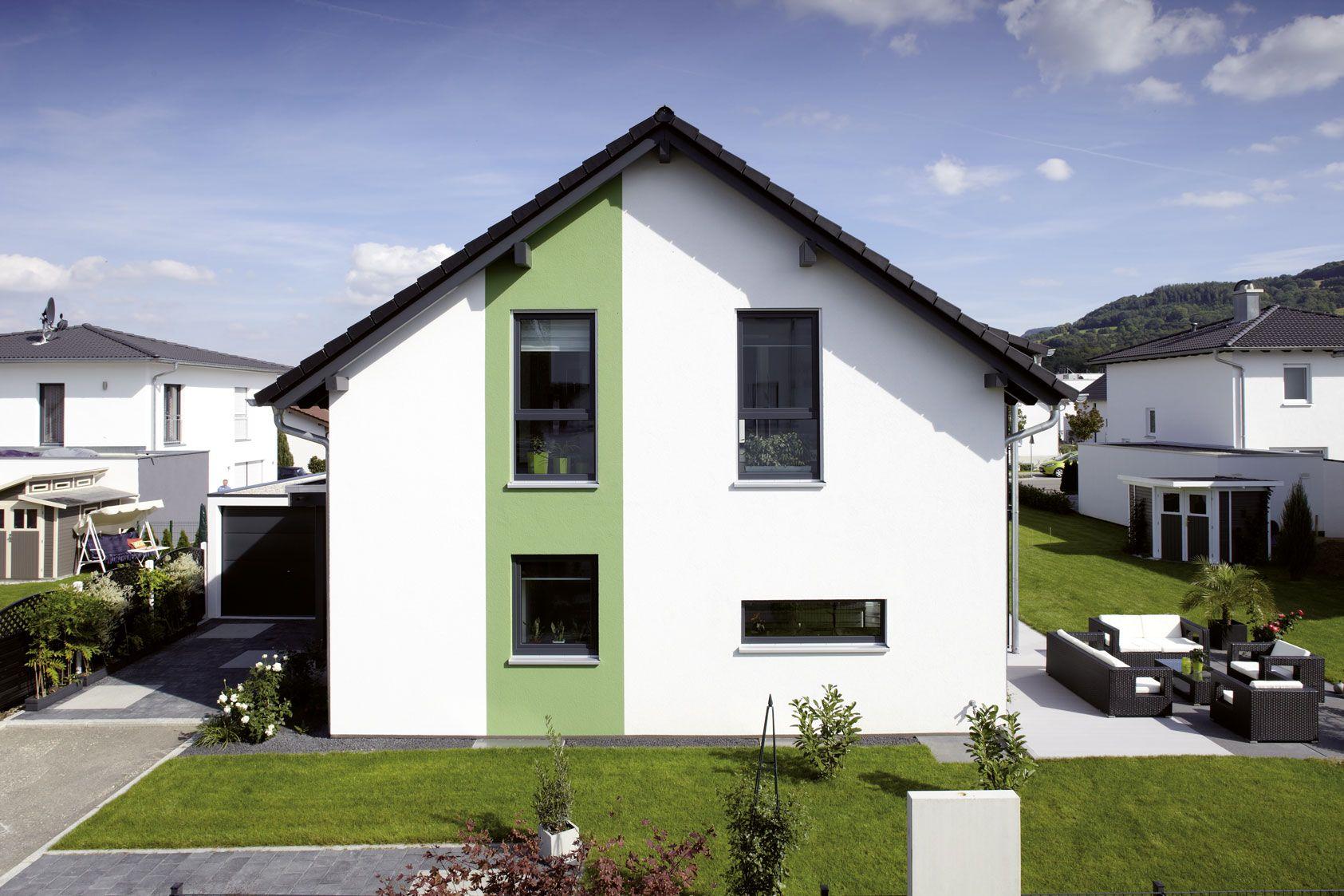 The White House Fertighaus weiß geputztes fertighaus mit grünen farbakzent einfamilienhaus