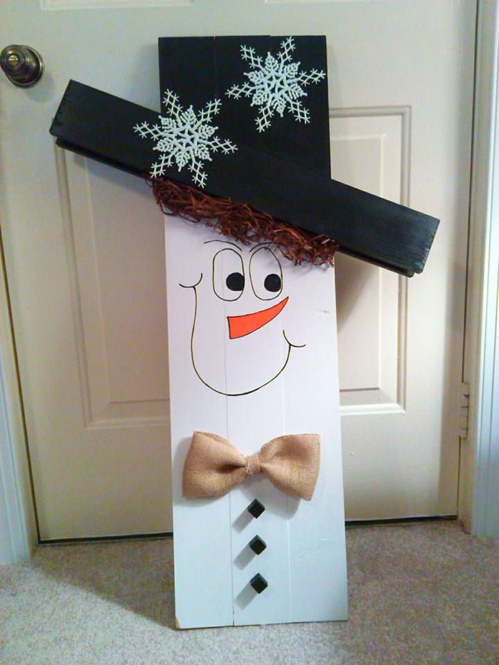 On one side you have a snowman and on the other side you for How to make a wood pallet snowman