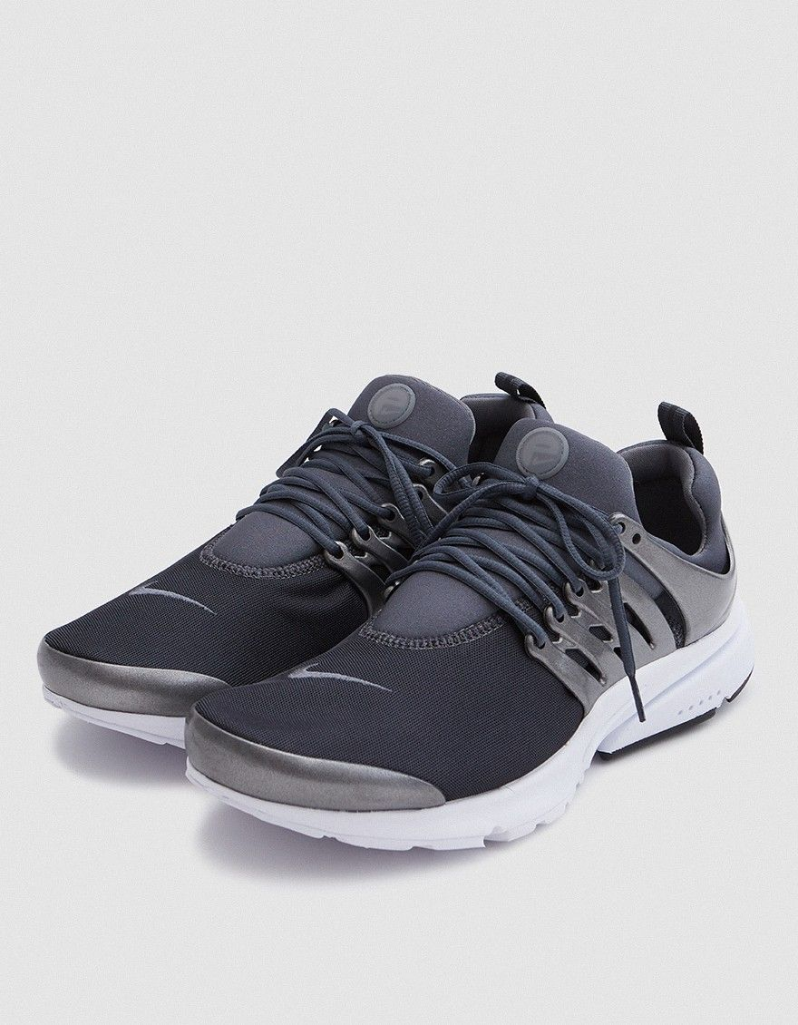 f45f6b14e47b Modern runner from Nike in Hermatite. Mesh upper. Sock-like construction.  Lace-up front with round woven laces. Heel pull tab. Molded midfoot cage.