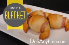 Cuddle up while watching the big game with this classic blanket with a twist. Tender slices of Black Forest Ham intertwined within a buttery croissant and rich cheddar cheese. Serve it up warm with a spicy mustard dip. #DeliAnytime