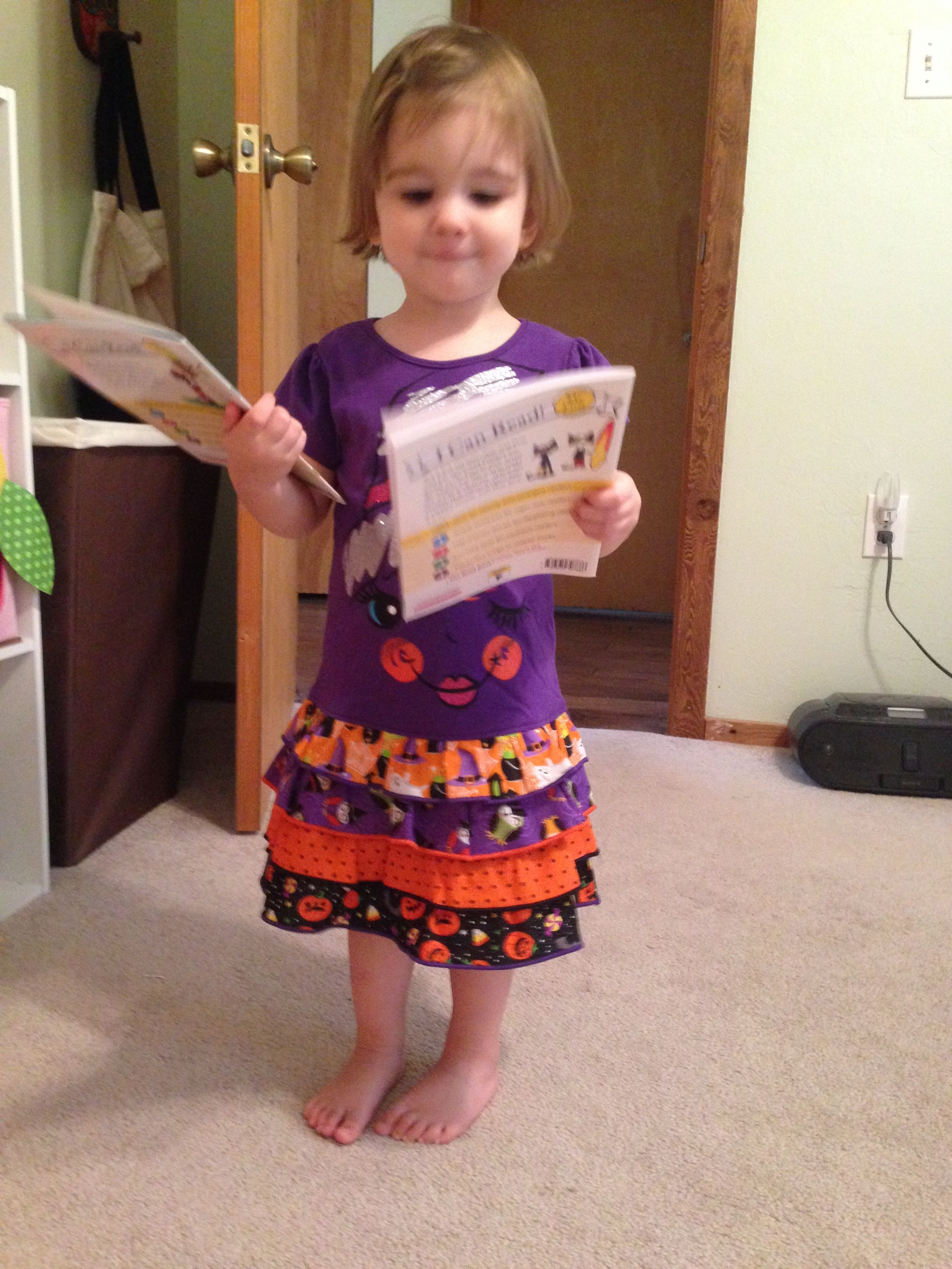 Grandma Melissa made this cute ruffle t-shirt dress with the LAYER CAKE pattern.