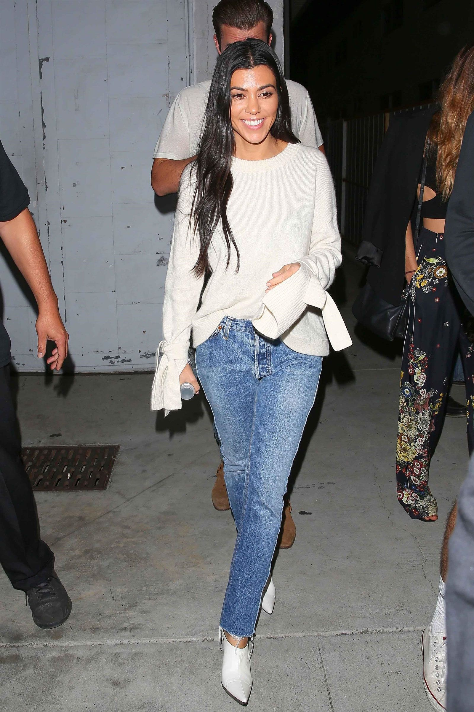 a5bffcc8f7aa Kourtney Kardashian s white bell sleeve sweater and crop hem jeans look for  less fall casual outfit idea - love the white mules!