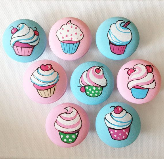 Pink and Blue Cupcake Nursery Baby Girl Nursery Dresser Knobs baby Girl Nursery Decor is part of Cupcake nursery, Nursery decor girl, Rock crafts, Painted rocks diy, Vintage cupcake, Cupcake painting - 4  cabinet drawer  These screws will not be long enough  Please contact your local hardware store to see if the longer screws are available before ordering     Cupcakes are randomly selected for painting by the artist  If you prefer to choose your own, please provide any specific requirements, including background colors during checkout  Please note, drawer knobs are sold individually  Please follow example below to order multiple quantities EXAMPLE for 6 knobs Quantity 1 Set Quantity Set of 6 Thanks! Dania