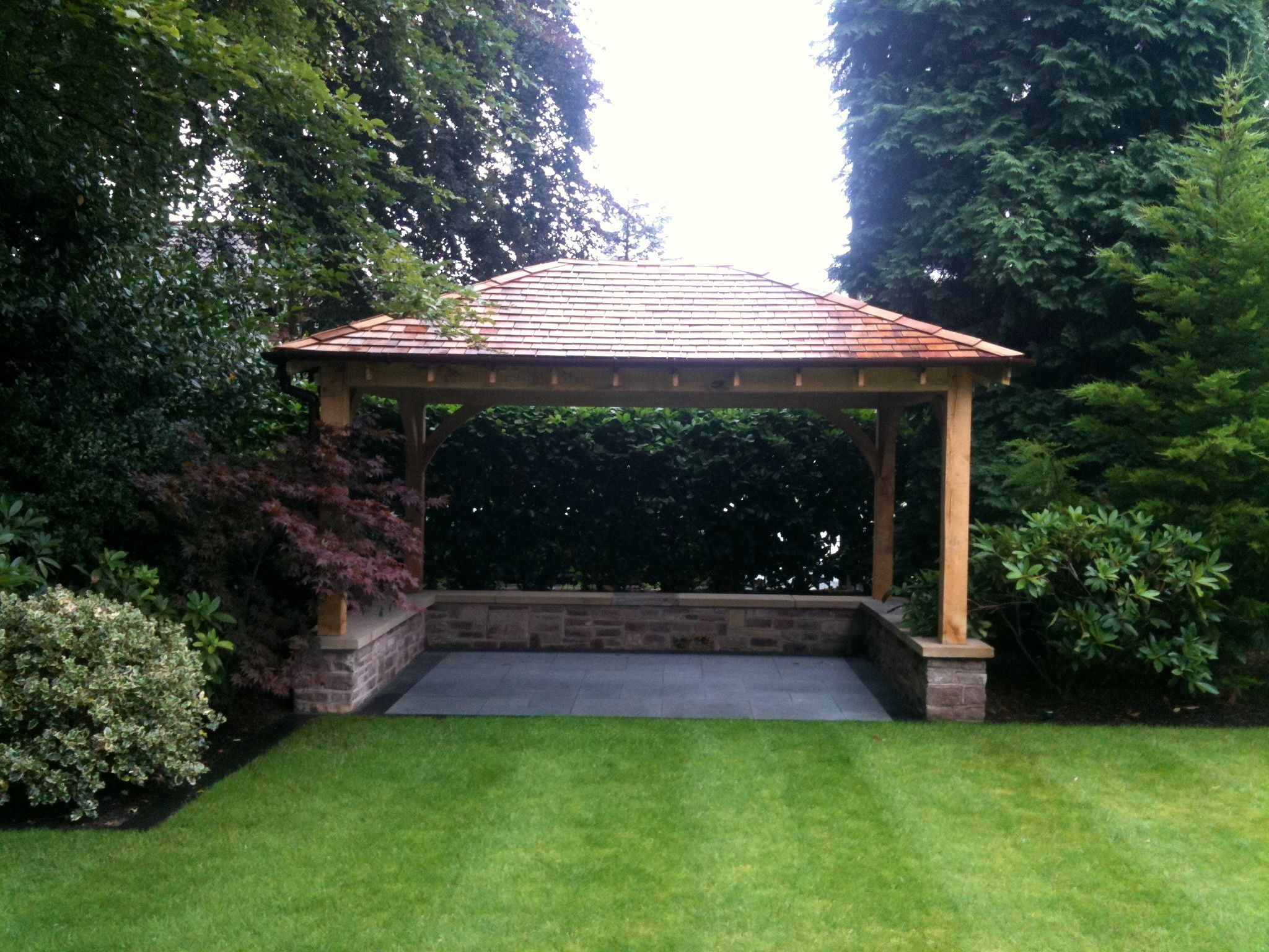 Green oak and cedar gazebo designed and built by classic paving