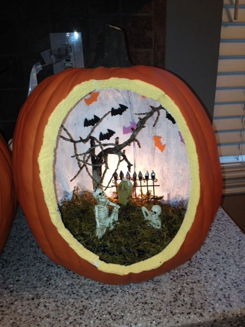 Halloween diorama using carveable faux pumpkin.