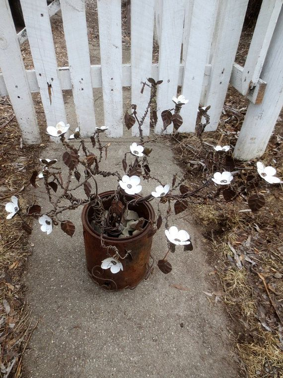 Vintage White Forever Blooms will brighten your space in any season! I created this shrubbery from vintage rusted barbed wire. The Forever Blooms