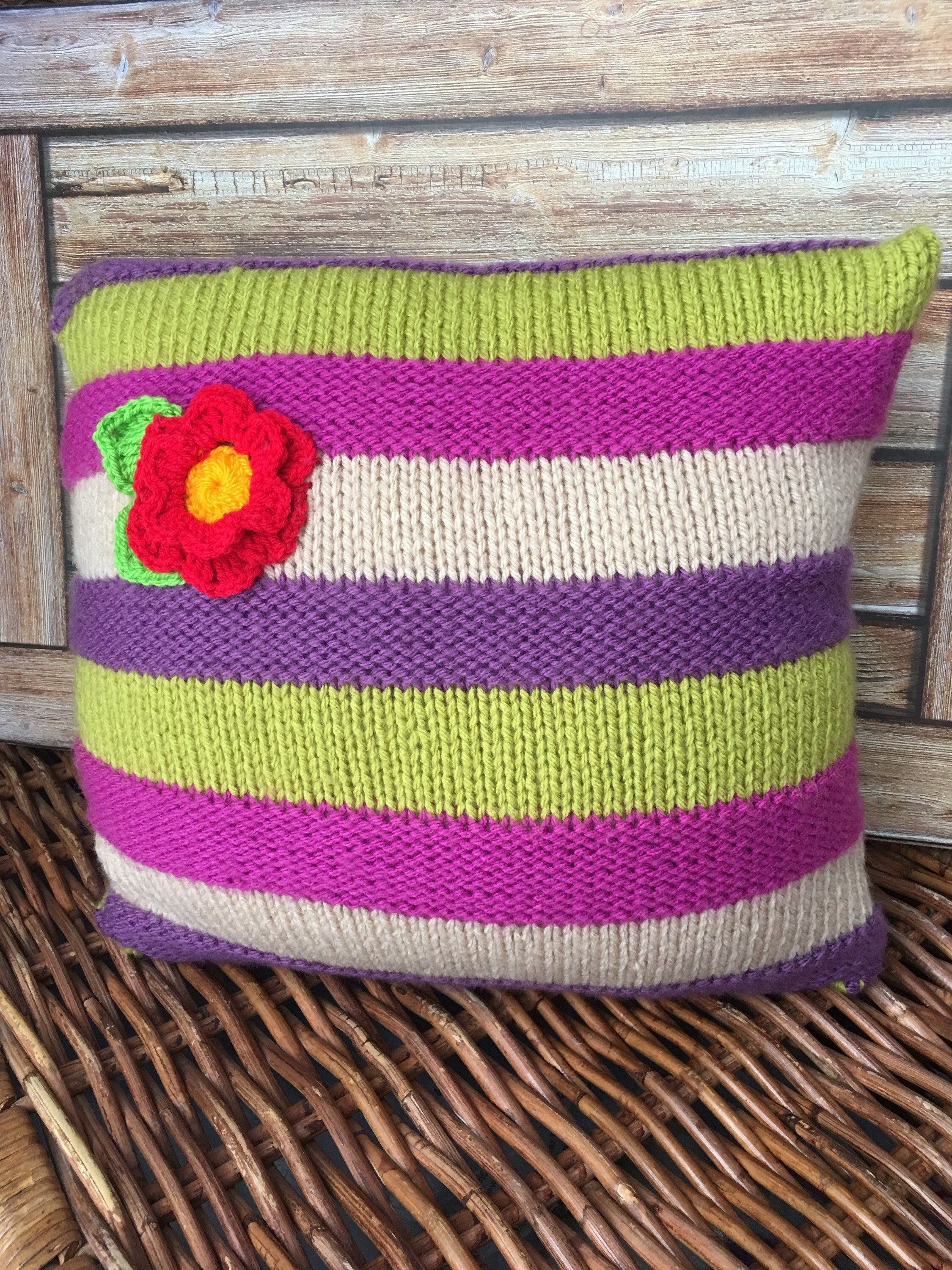 Cushion hand knitted stripes of green purple beige with a red