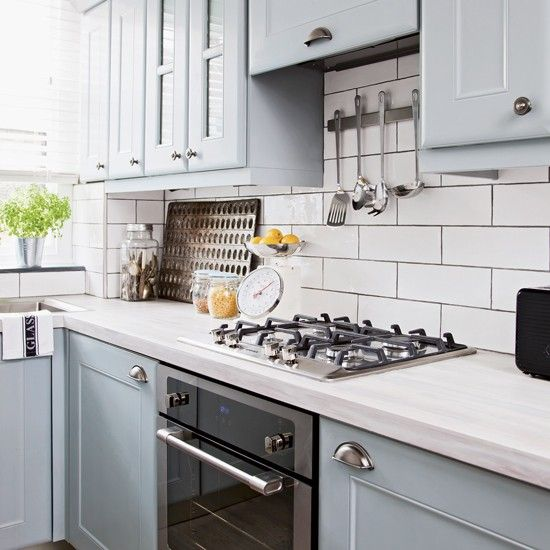 Metro Tile Kitchen pale blue kitchen with white metro tiles and black oven | black