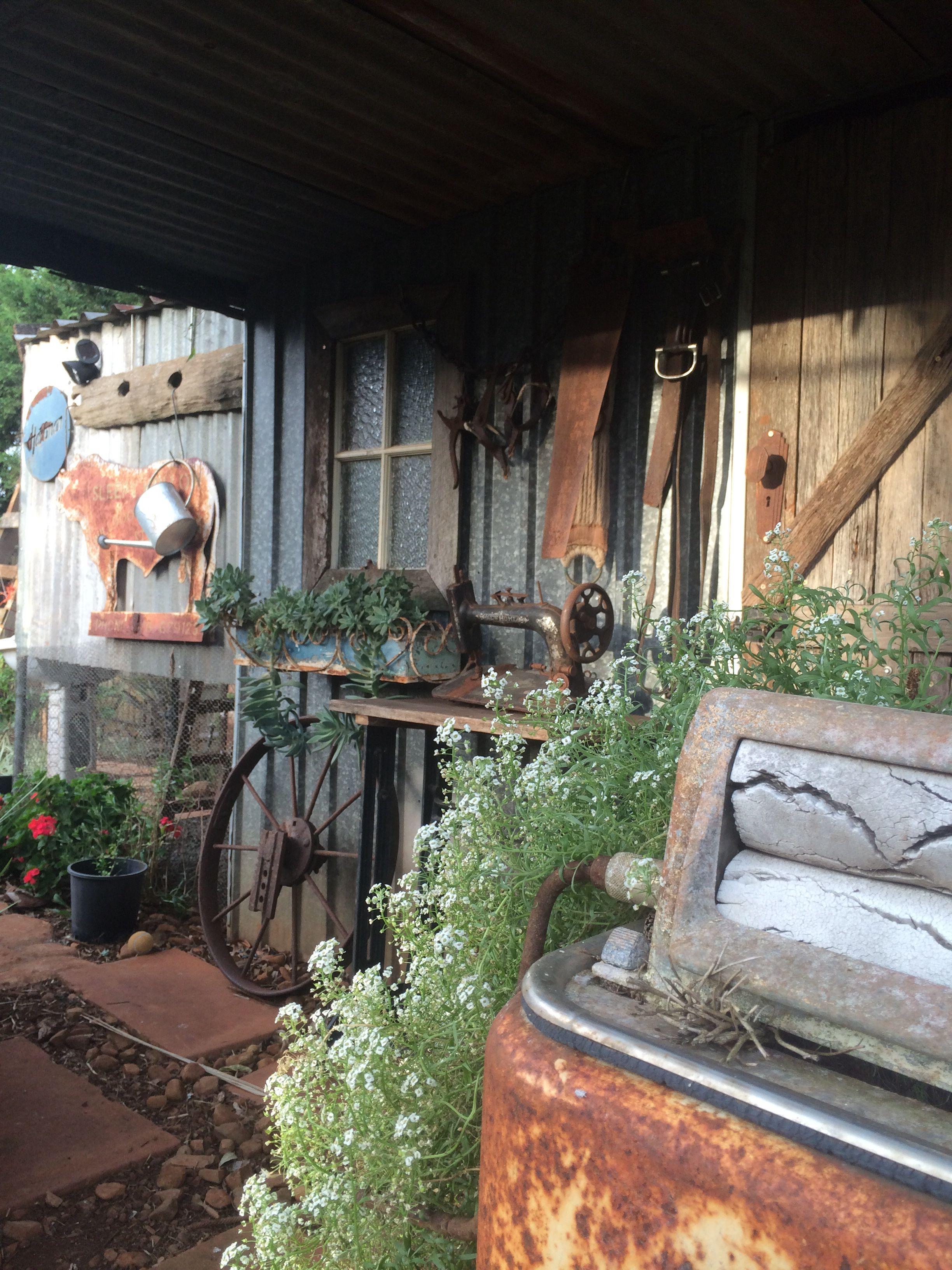 Wagon wheel. Rusty washing machine planter. Toowoomba