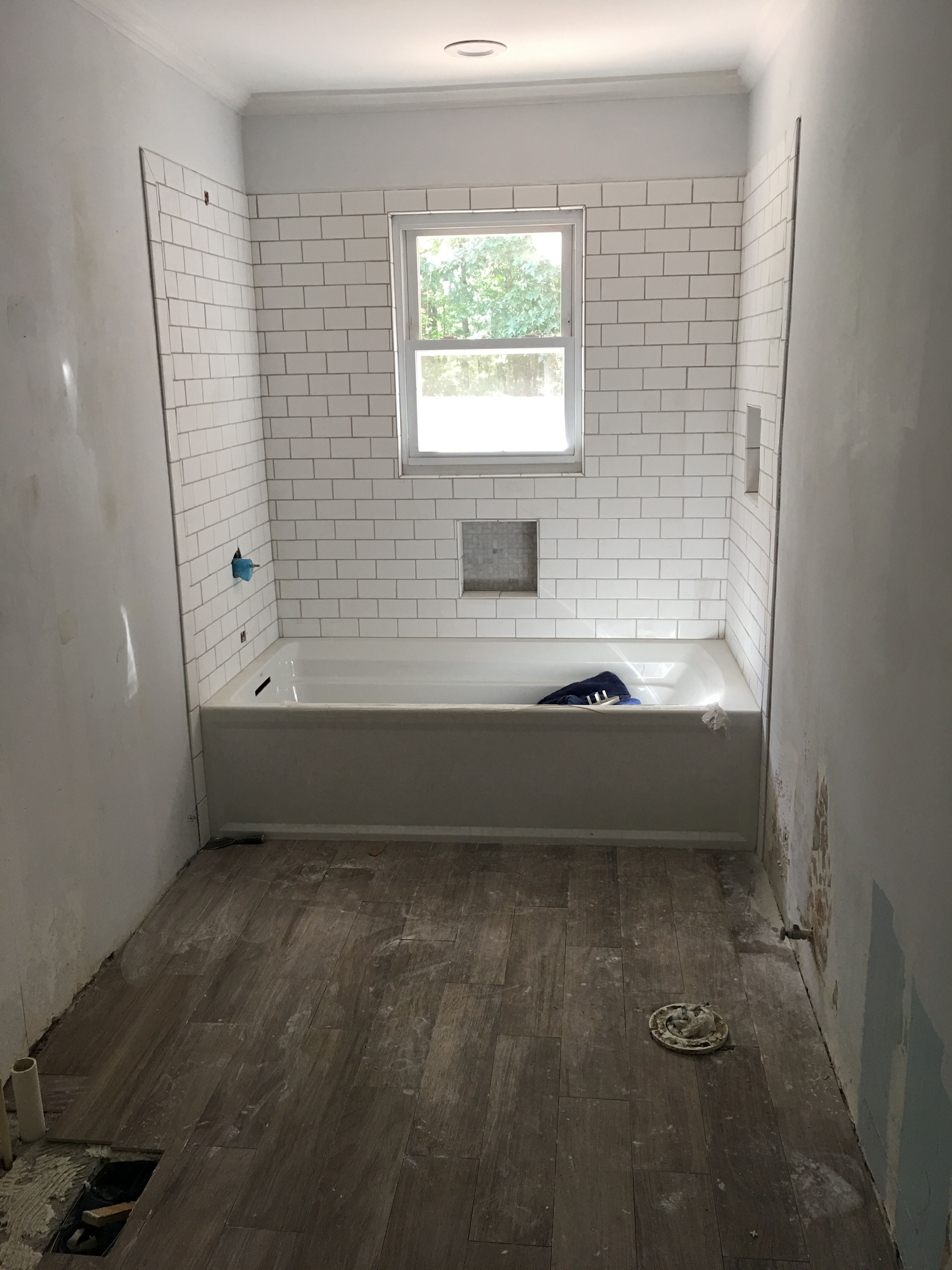 Love the white subway tiles with gray grout in my remodeled bathroom ...
