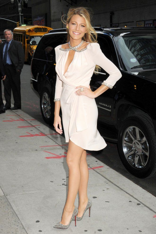 Celebrities in Louboutins... Blake Lively accentuated an embellished wrap dress with sparkly Louboutin Pigalle pumps
