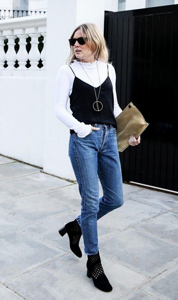 c61333e7fd Fashion Me Now layers a black cami over a white turtleneck top.