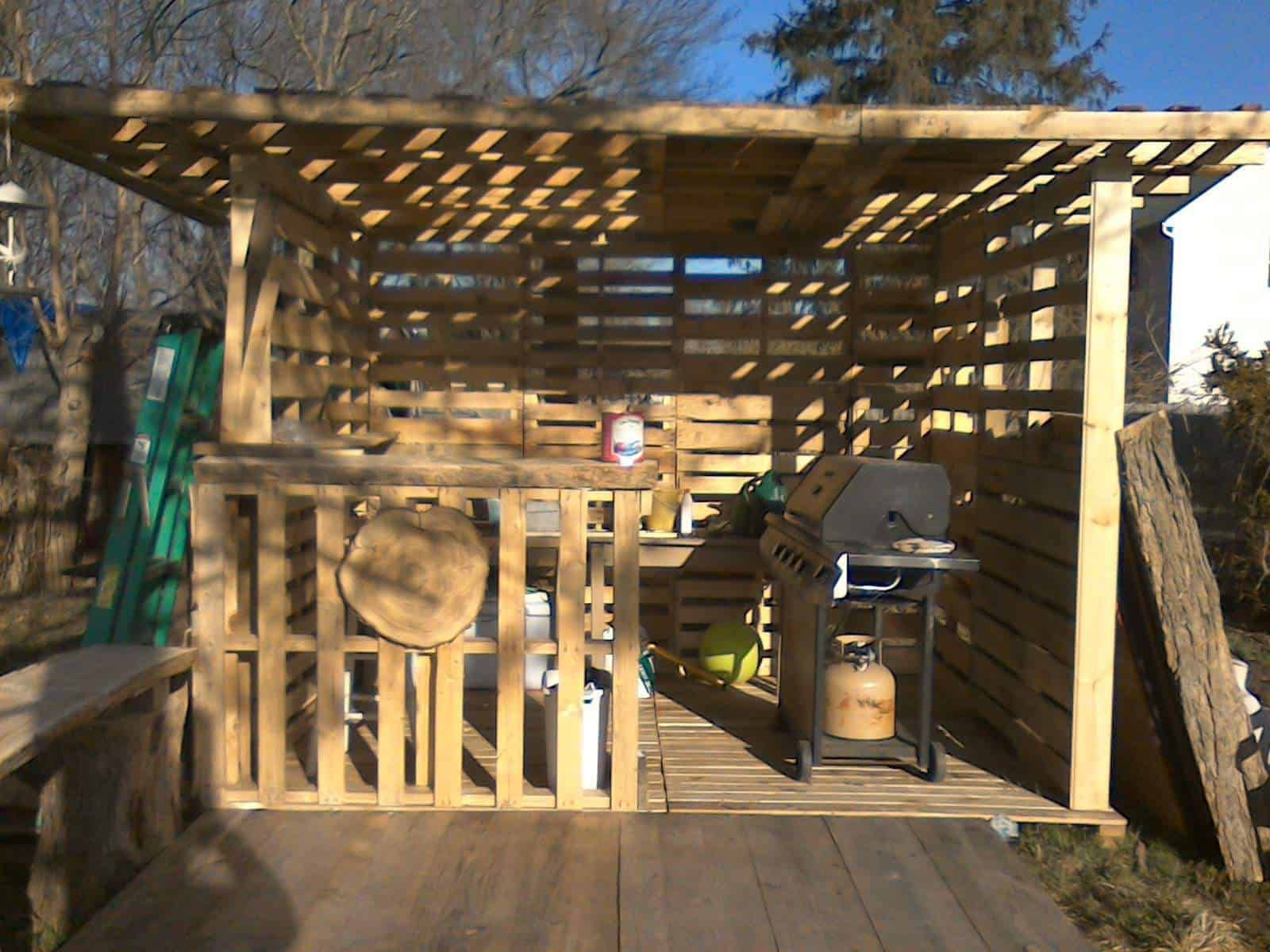 Pallet Hut  Work in Progress is part of garden Decking BBQ - We started on a Friday ànd my Monday close to done  My son went ànd got free pallets and reading on what you can make with pallets we began to work  I am using my pallet hut for entertainment and garden room  bbq garden hut palletbed recyclingwoodpallets