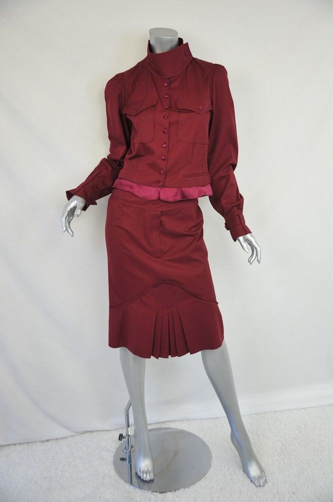 a0d32b43f4b This beautiful Yves Saint Laurent skirt suit features silk-covered buttons  and silk trim at the jacket hem. We love the banded collar as well as the  flirty ...