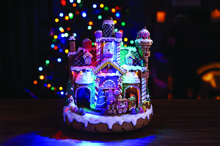 led gingerbread house with moving train christmas decorations illuminate