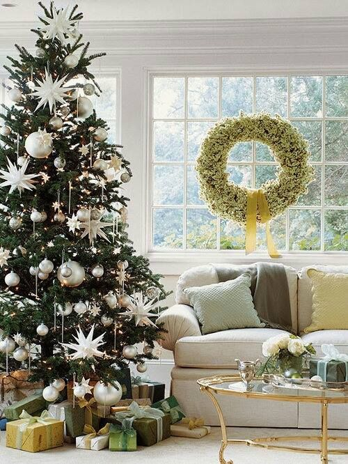 peaceful living room with white christmas decorating theme for holiday home decor with beautiful christmas tree charming christmas decorating idea