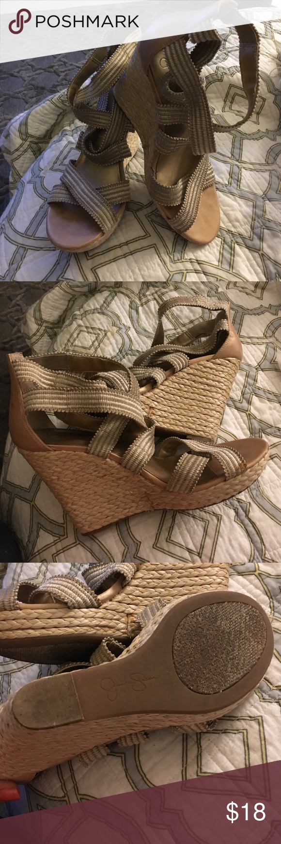 Jessica Simpson wedges w/ metallic back&rope wedge Super adorable Jessica Simpson wedges. Shoes have elastic straps with a threaded upper and metallicy backing. Wedge is a woven straw/rope and has a rose gold, metallic back. I believe the size is 8.5, but cannot confirm as there is no size stamp on the shoe. Shoes are in great shape with normal wear and tear. PS: They are fantastic for the summer! Jessica Simpson Shoes Wedges