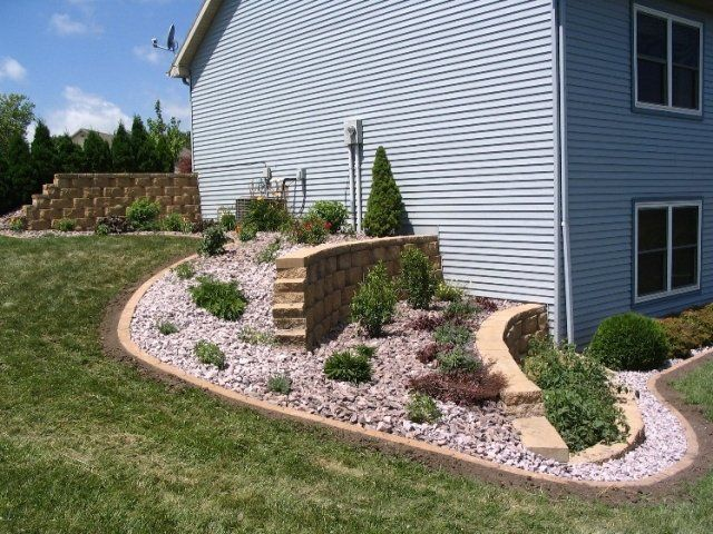 Turning A Steep Side Hill Into An Easy To Mow Tiered Bed Outdoor Gardens Tiered Landscape Side Yard Landscaping