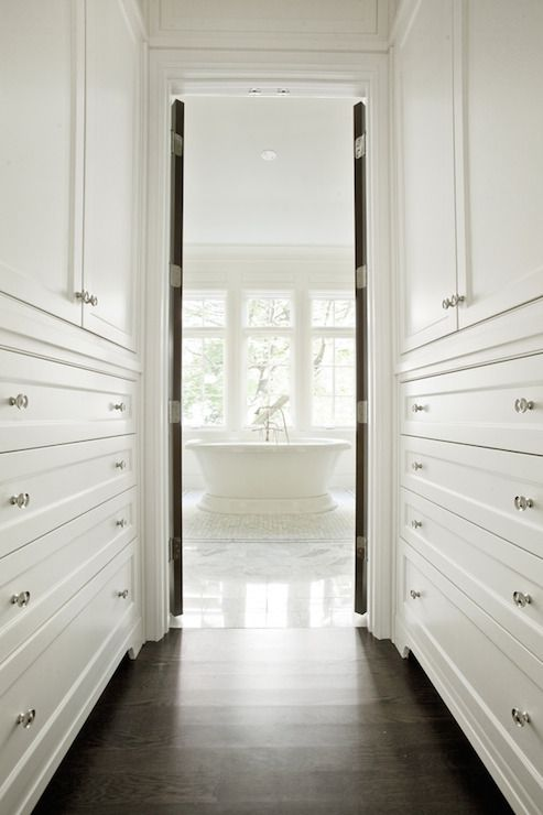 Long Narrow Walk Through Closet Features Floor To Ceiling Built In Cabinets Atop Dark Stained Oak Wood Floors Home Closet Bedroom Walk Through Closet