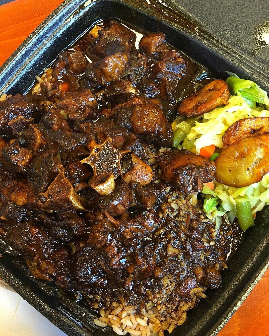 large ox tail rice and peas steamed cabbage plantain