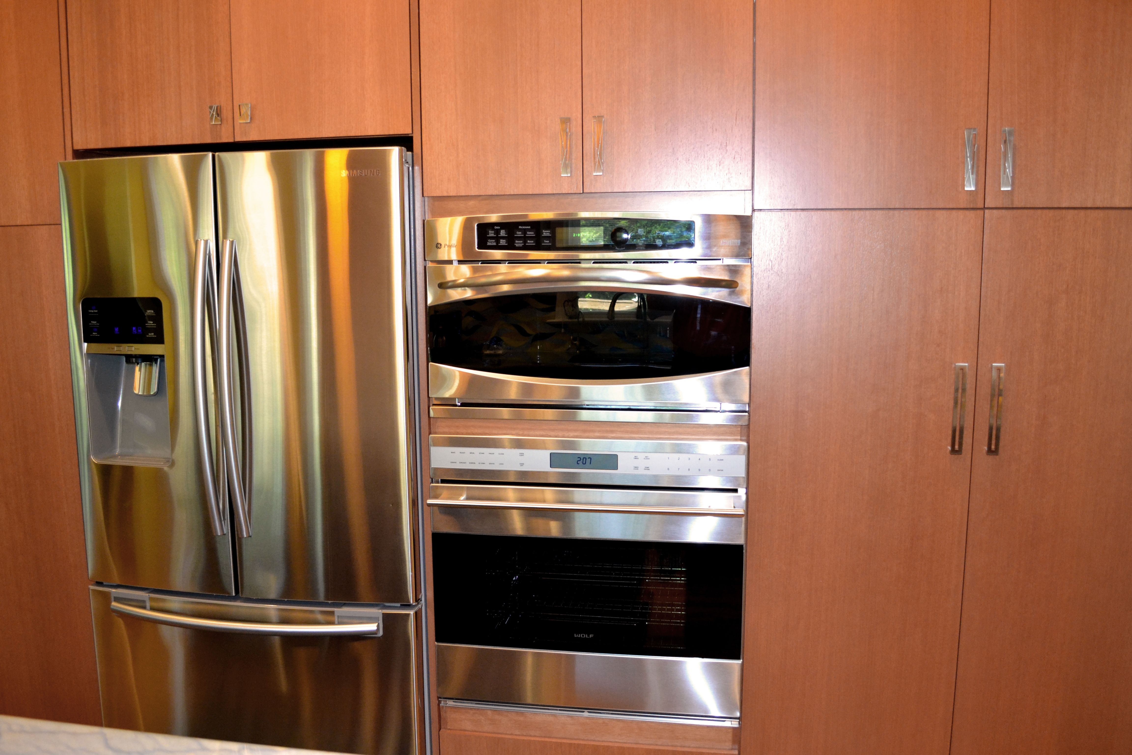 Full height kitchen cabinets with a stainless steel fridge ...