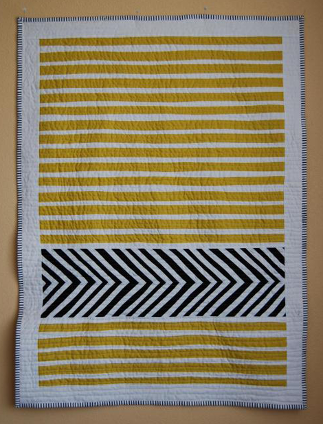 a quilt with a strip of chevron This would be great for a baby's ... : chevron stripe quilt pattern - Adamdwight.com