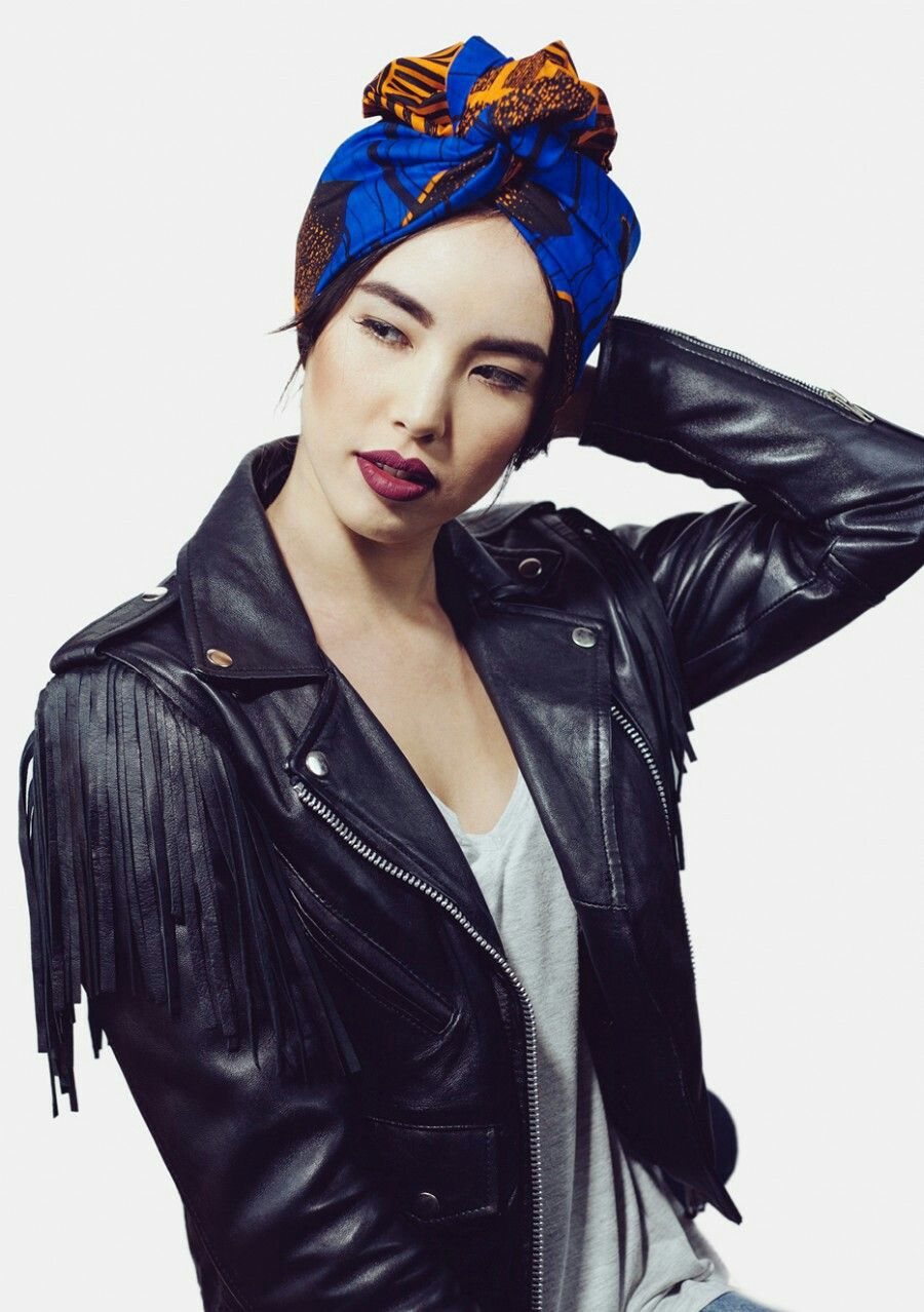blue african print headwrap. fashion turban. black leather jacket with fringes. Asian girl