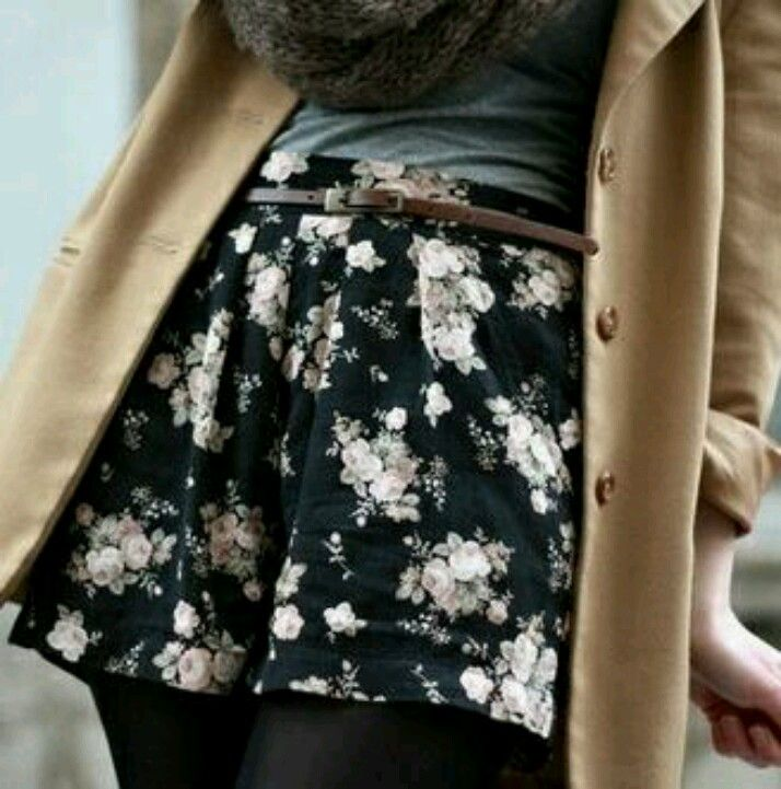 Tan Blazer paired with a Floral printed skirt over black tights
