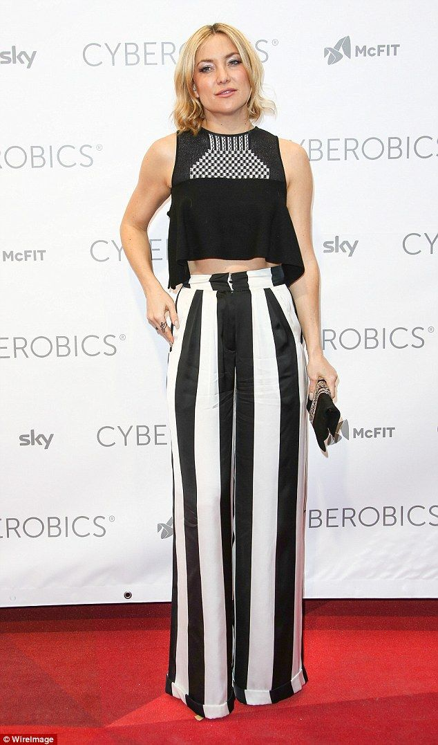 Sexy in stripes: Kate Hudson turned heads in a pair of Beetlejuice inspired trousers as shelaunched her new Cyberobics sports studio in Berlin on Thursday