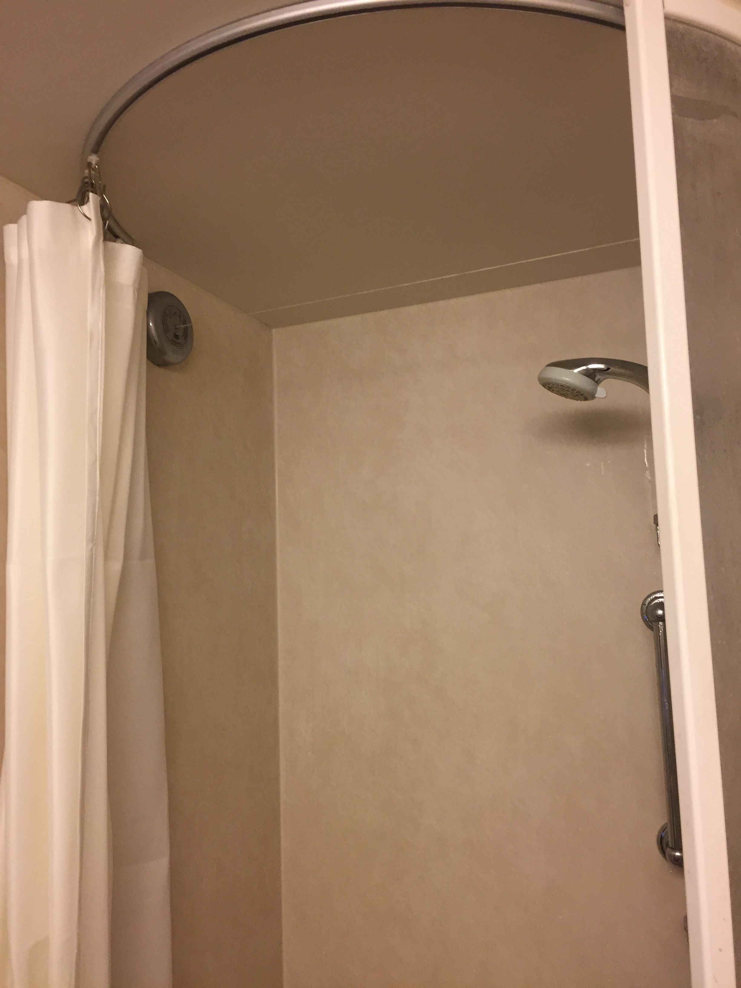 A Small Shower In A Cruise Ship Uses The 6100 Flexible Curtain