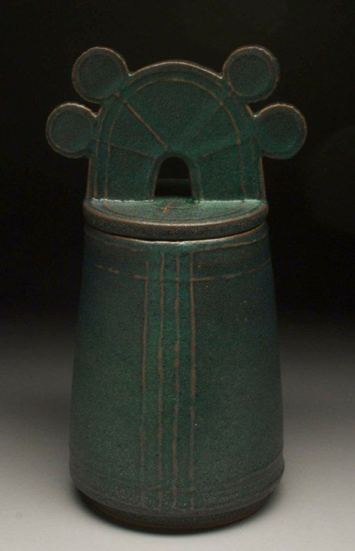 robin edgerton pottery covered jar, 2012. after japanese bronze bells of the 1st-3rd century, mayan pottery, and mickey mouse. Reitz green over stoneware in oxidation.