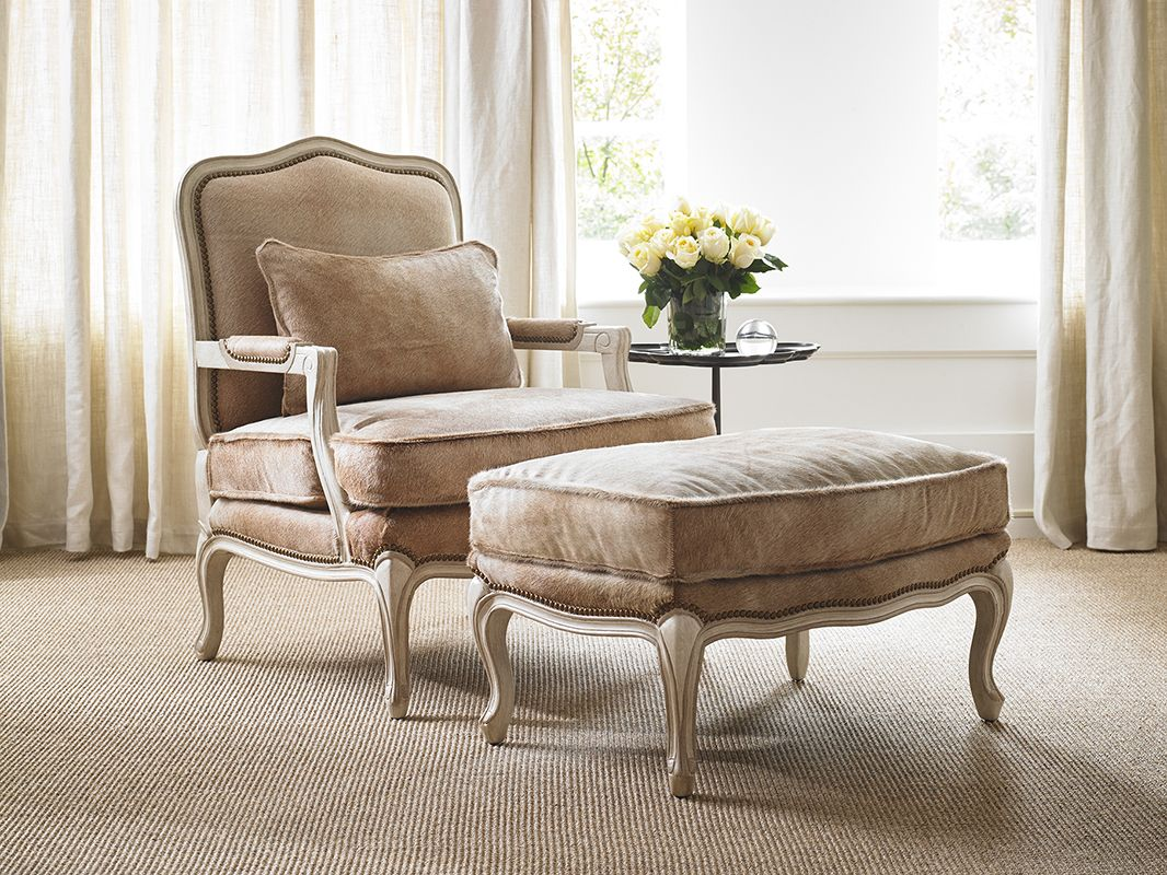 The 1436-00 Bonnie Chair and ottoman looking handsome in this summer brindle hair on hide!