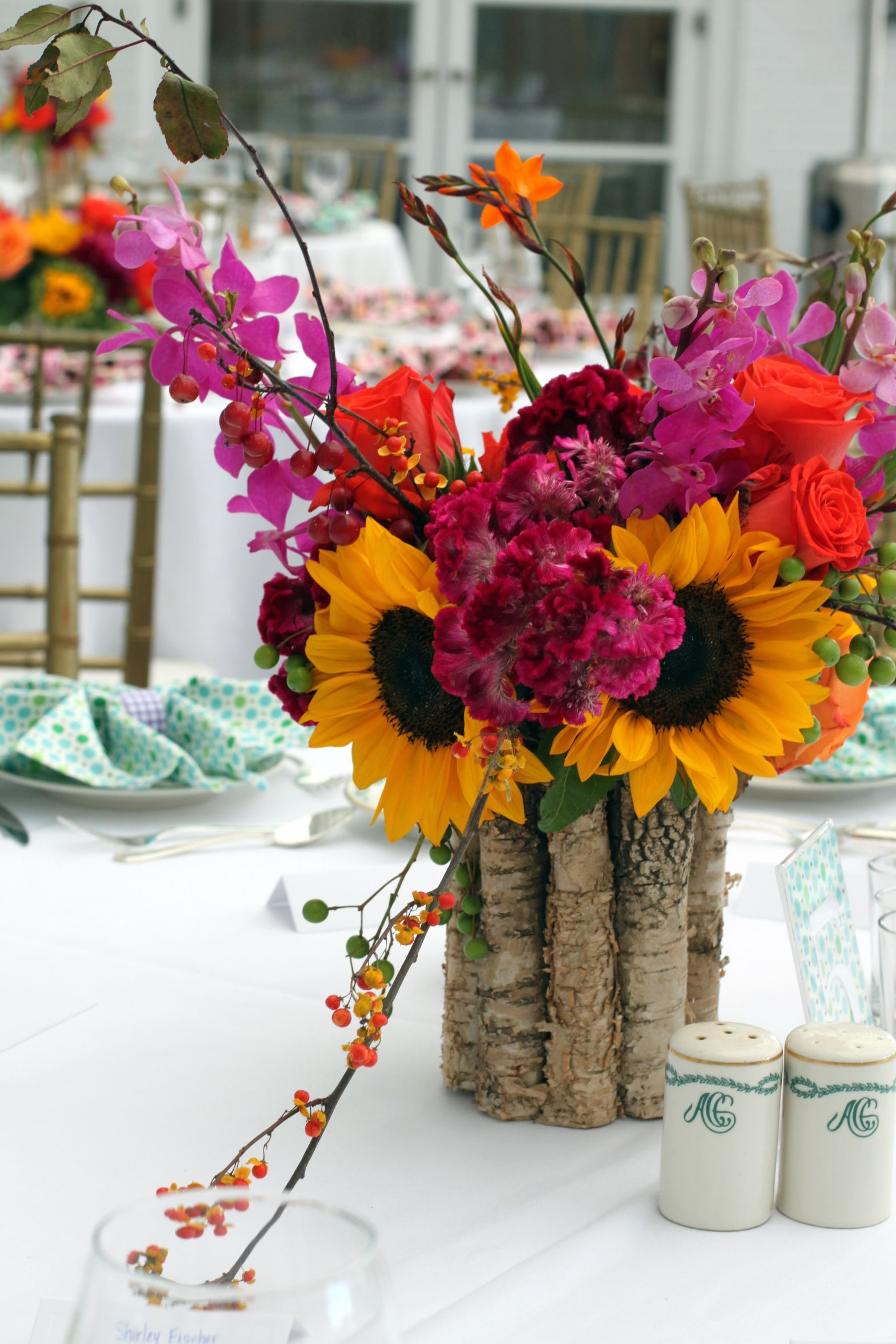 Late summer fall wedding centerpiece orchid sunflower rose