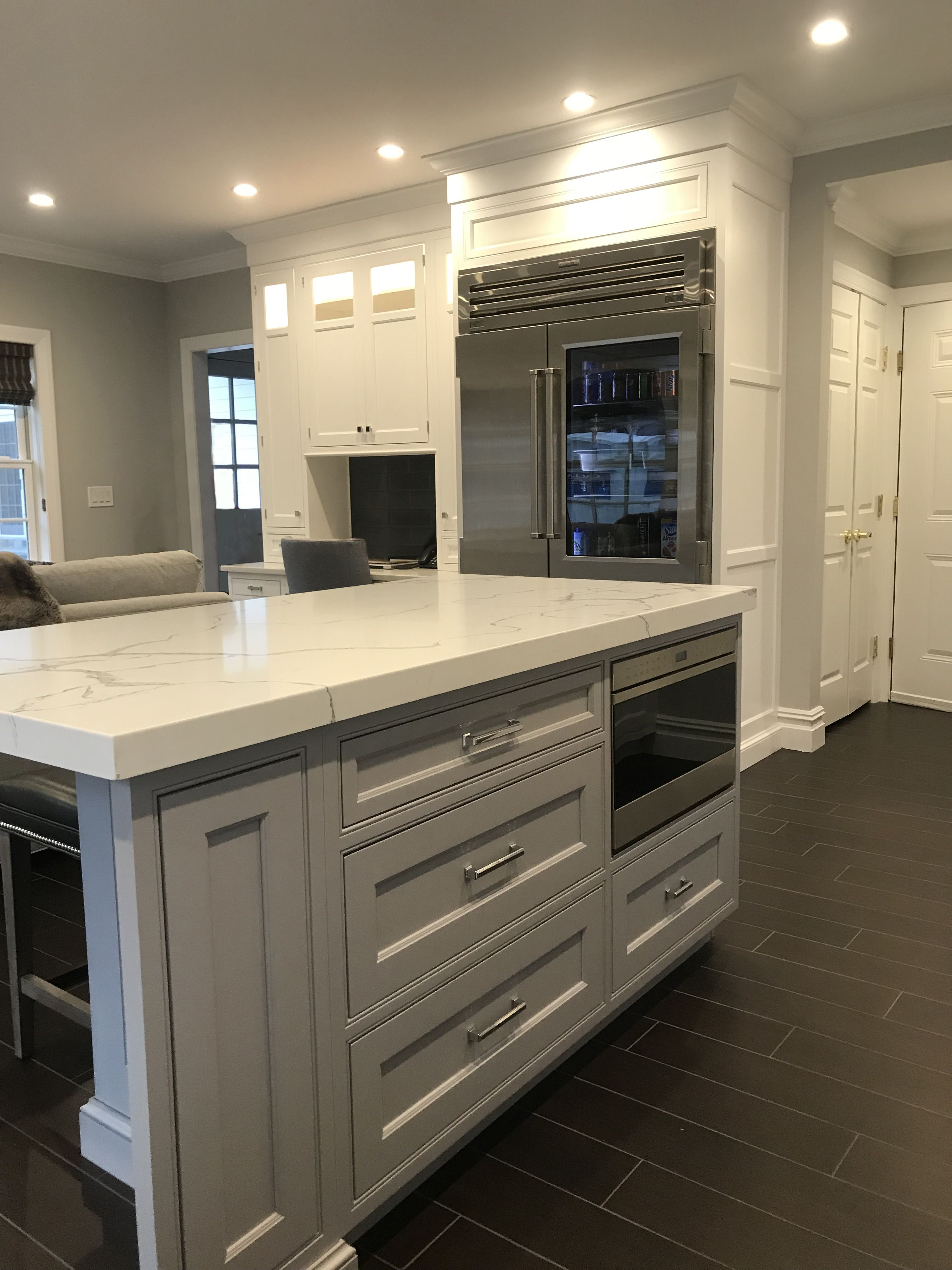 Ruttcabinetry In Warm Grey Tone Enhances White Perimeter Cabinetry