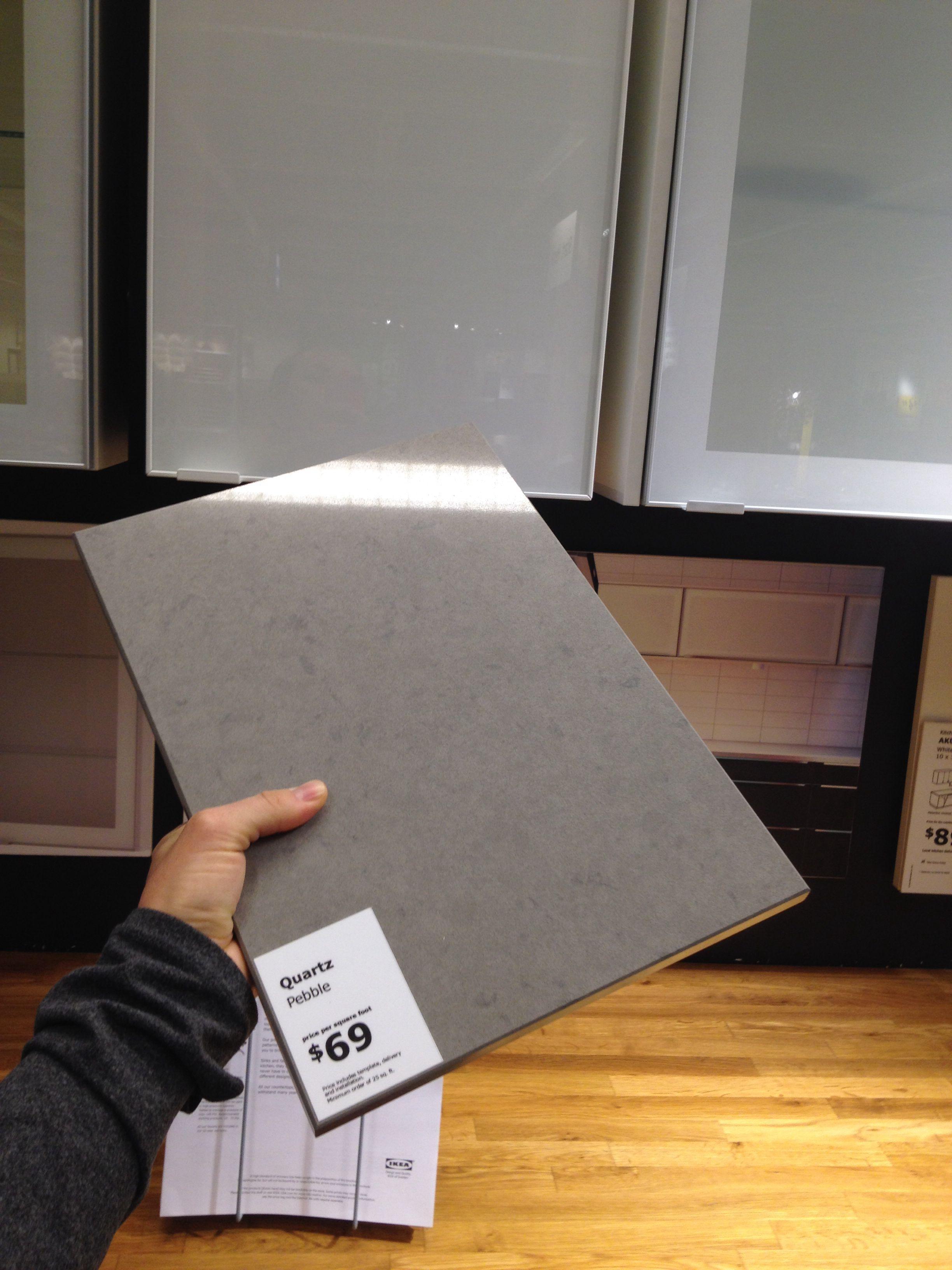 Grey quartz countertop maybe w/white cabs & dark walnut