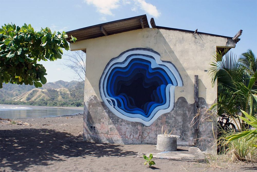 German street artist 1010, uses spray paint to create the illusion of portals into blank walls.