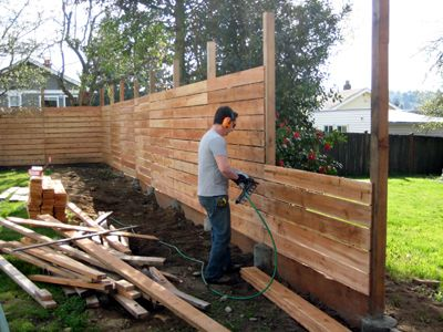 horizontal fence = only do this for if you need a fence to be tappered  heights (i.e. getting shorter and shorter) - Building A Horizontal Plank Fence Horizontal Fence, Fences And Pallets