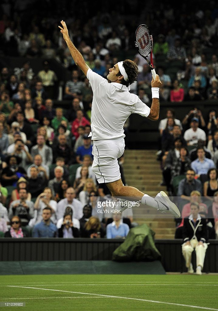 Swiss Player Roger Federer Returns The Ball To French Player Adrian Tennis Photography Tennis Photos Roger Federer