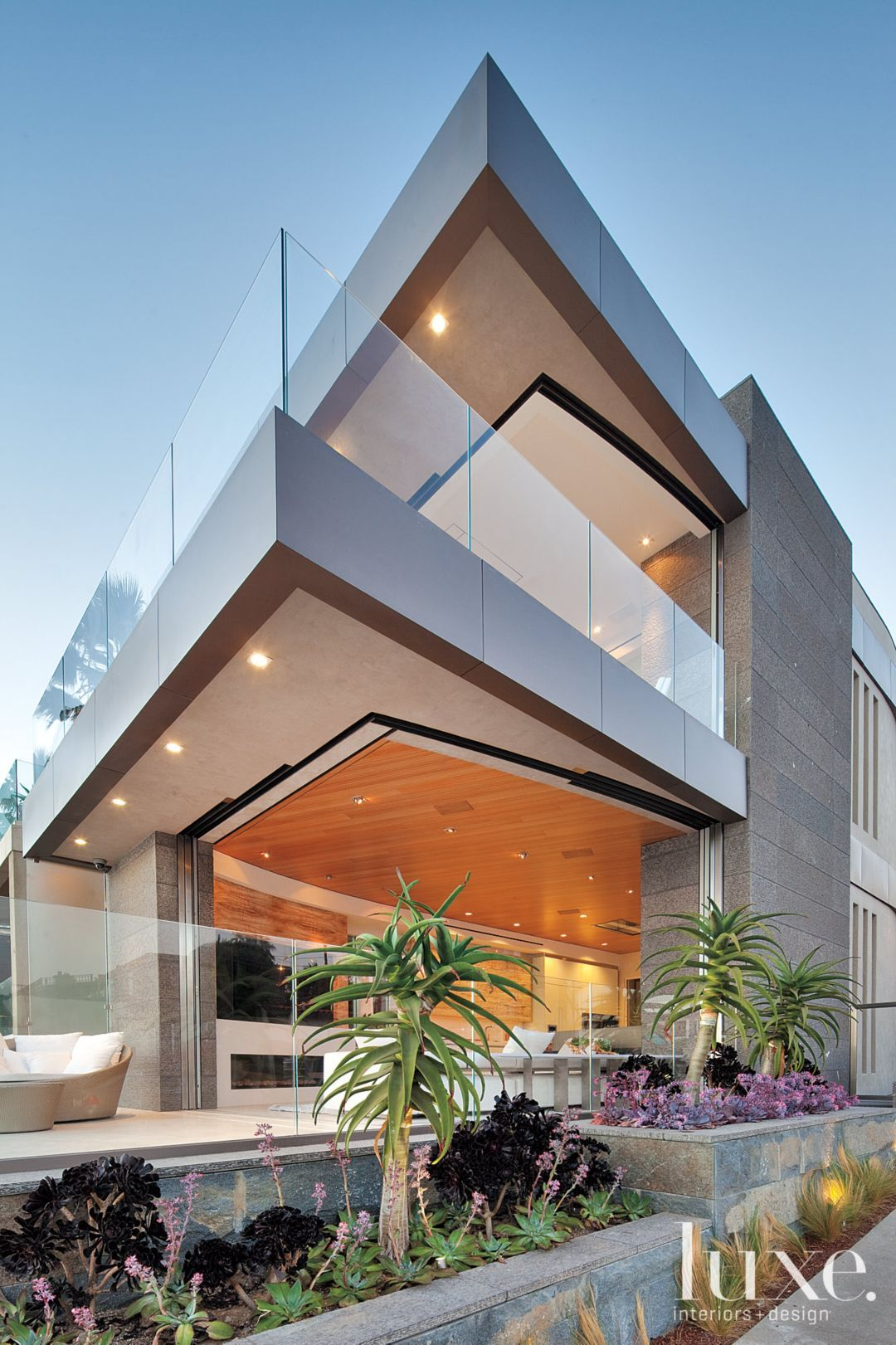 Beachfront Luxury Modern Home Exterior At Night: Luxe Magazine - The Luxury Home Redefined