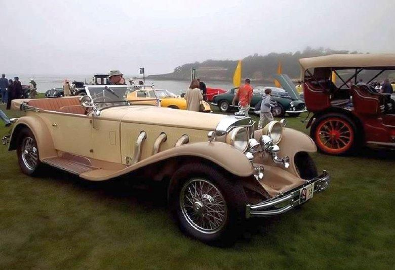 cream color convertible 1930 mercedes benz ss tourer with lots of chrome and gorgeous sweeping