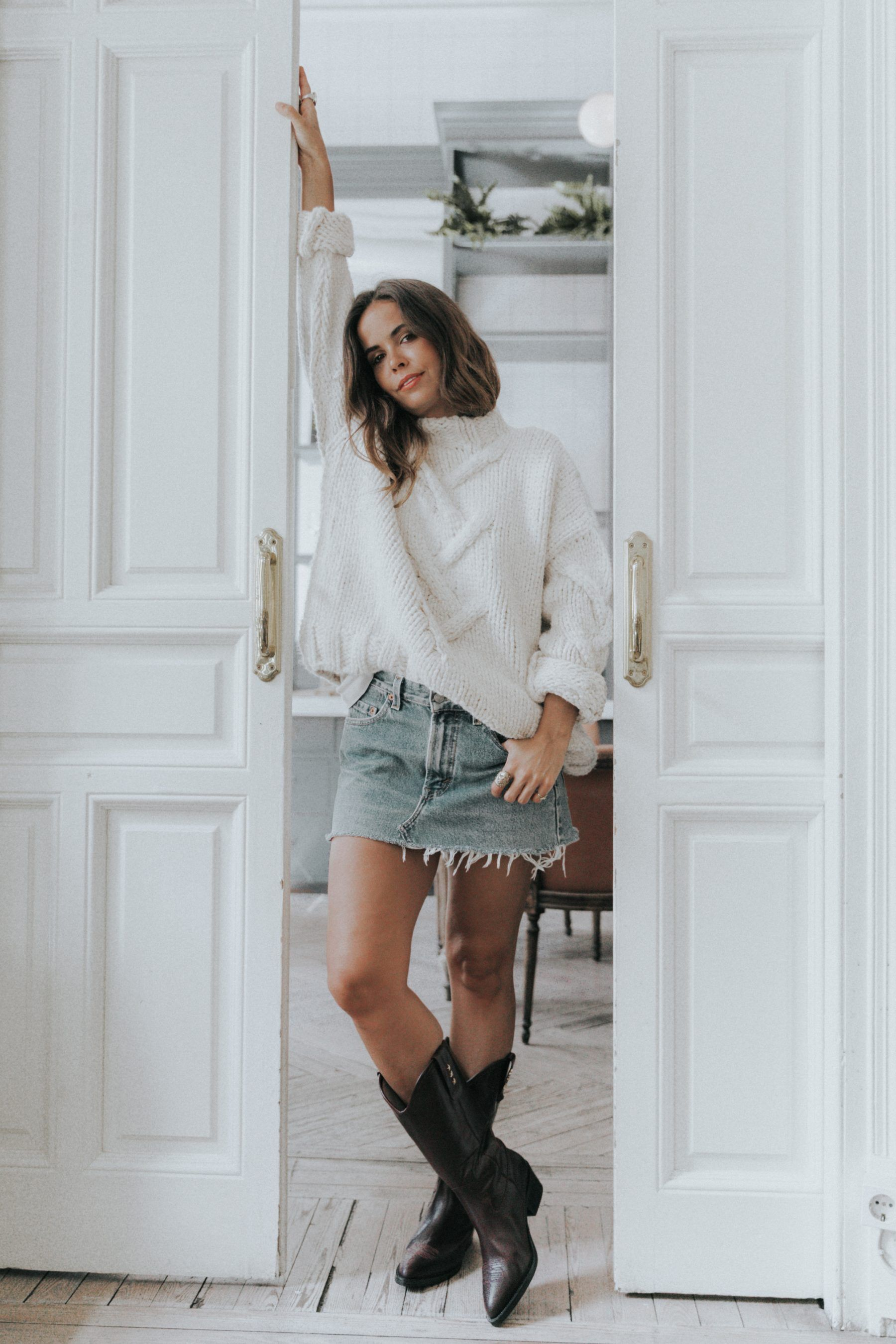 86d3b8b7fc Collage Vintage loves Jonak capsule collection. White knit sweater+denim  skirt+dark brown cowboy style boots. Fall Casual Outfit 2017