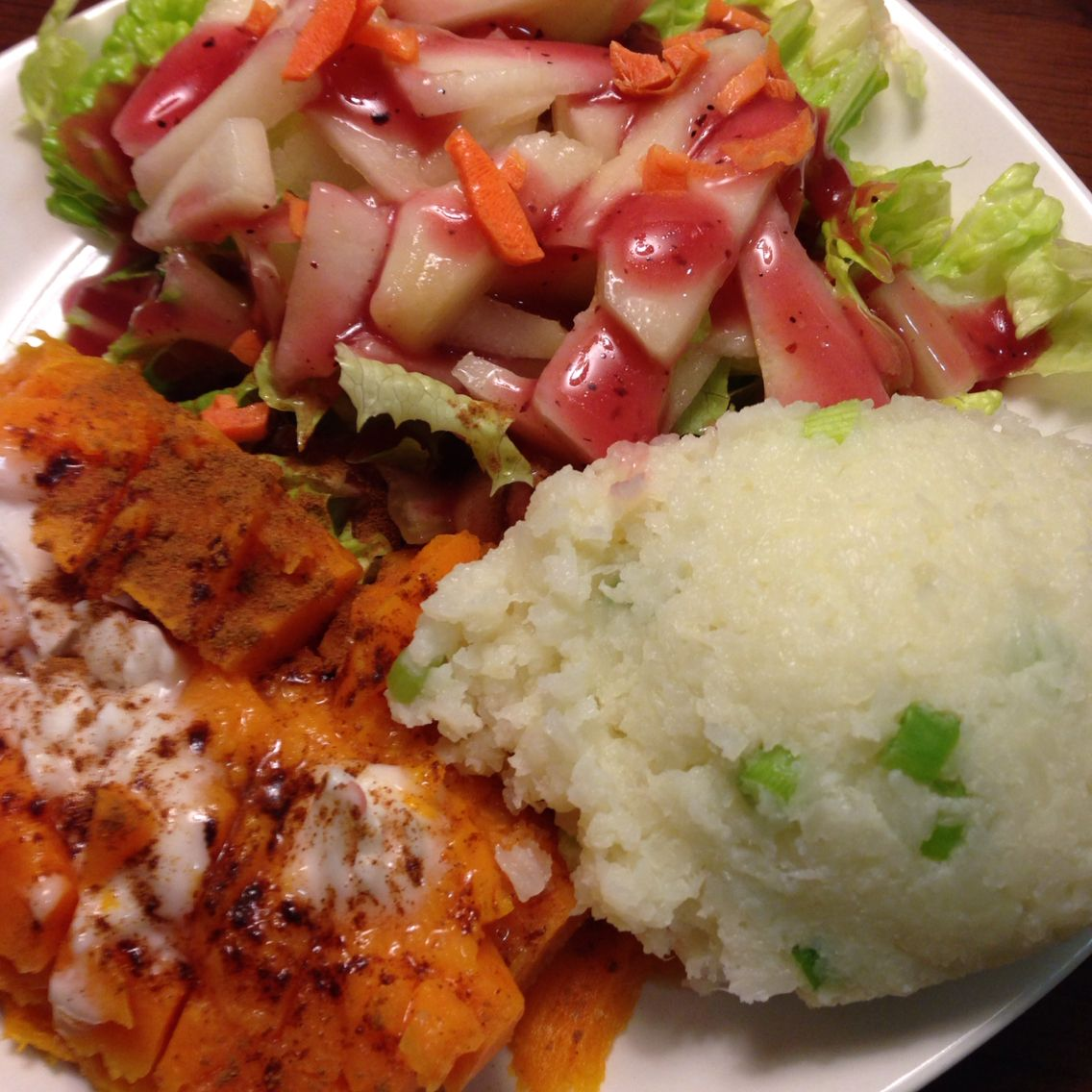 Raw Dinner with sweet potatoes, garlic cauliflower mashed potatoes, and a salad with raspberry vinaigrette dressing.