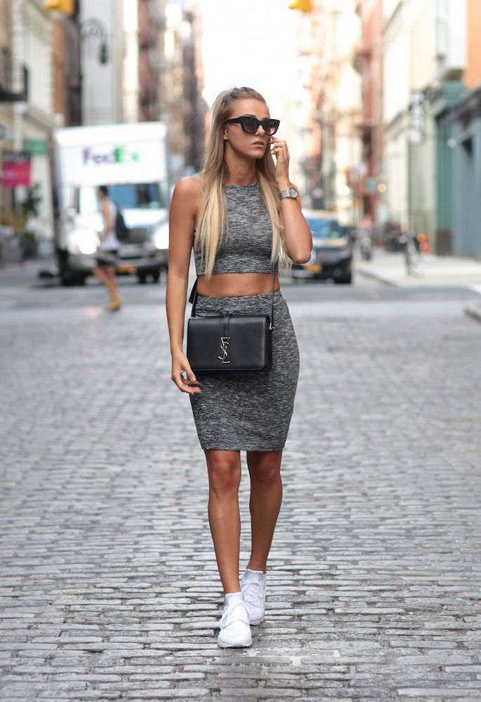 A grey skirt and crop top combo goes fabulously with a pair of white  sneakers!
