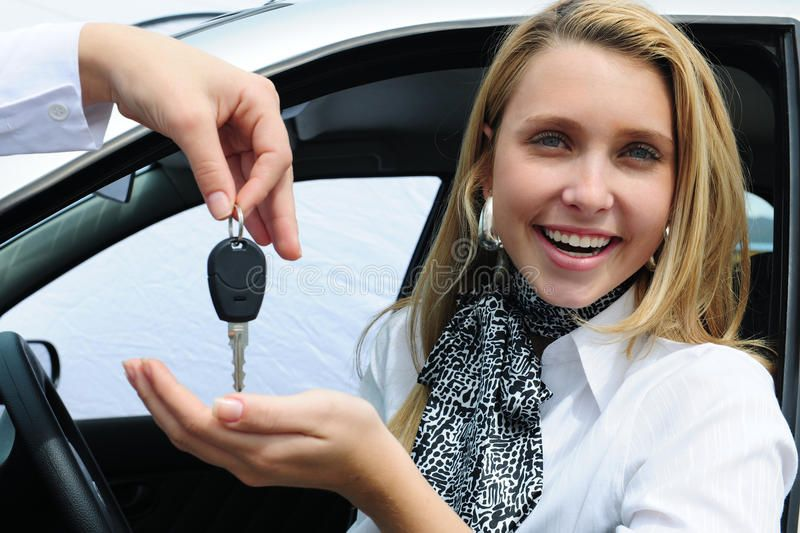Happy Woman Receiving Car Key From The Sales Man Ad