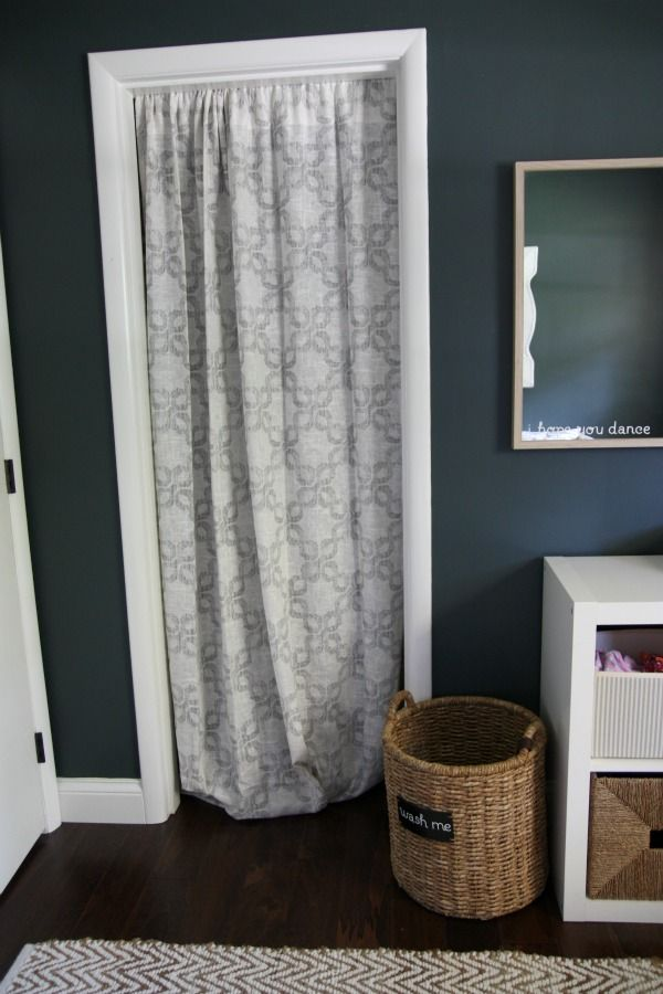 Curtain instead of closet door.I love this because all 5 of my kids have at  some point broken their closet doors! Replacing those gets expensive!