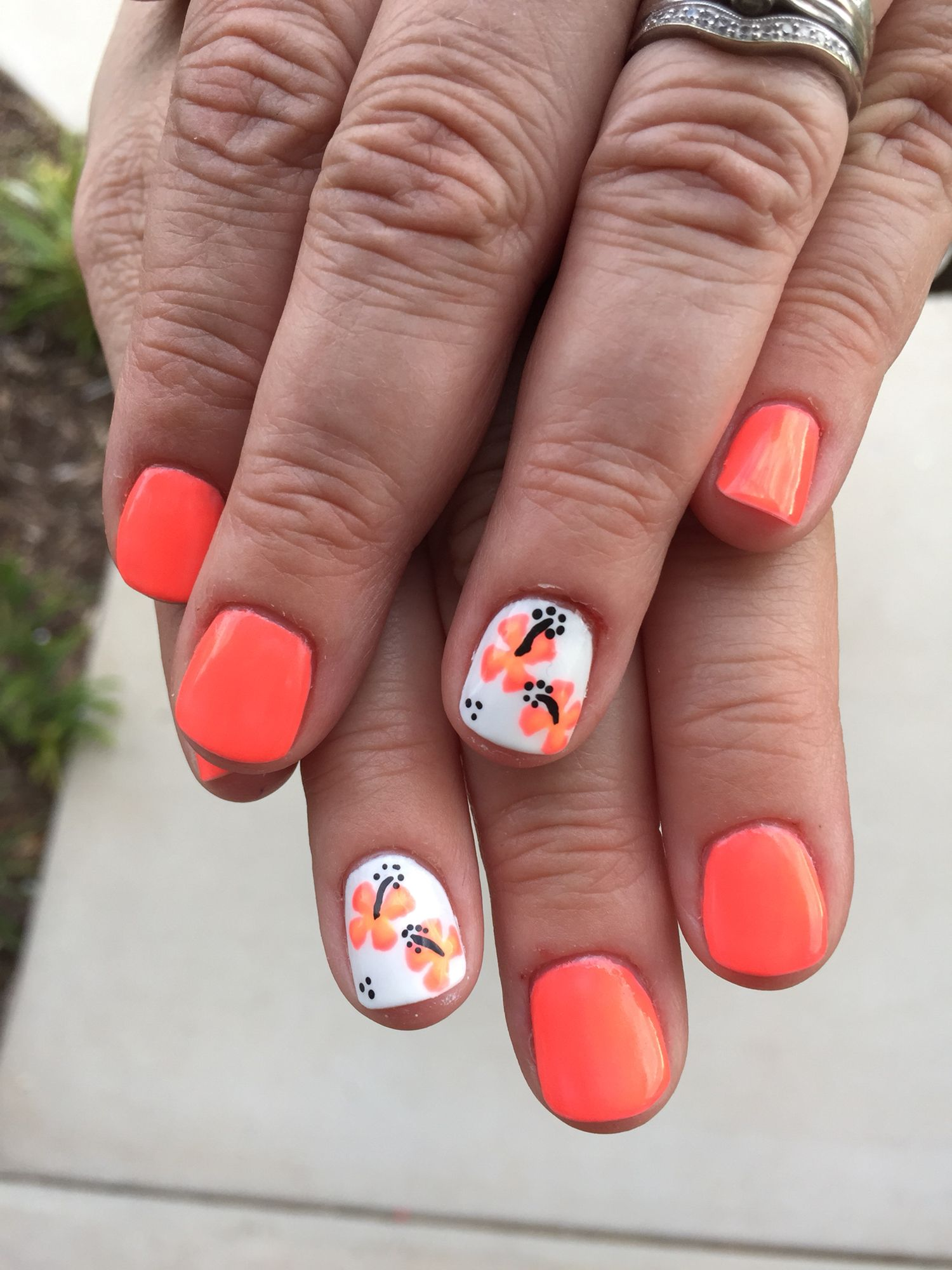 Bright Neon Orange Coral Gel Polish With Coral Hibiscus Flowers Over