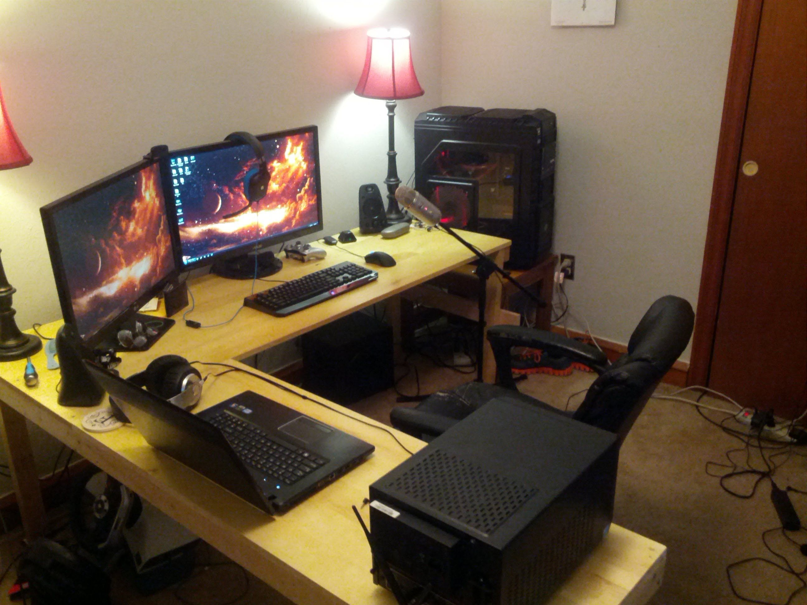 alluring pc gaming setup with two computer monitors and laptop