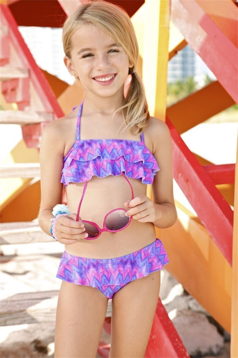 f0bfbca005f9 Peixoto Kids Poppy features a fun print that guarantees for a great beach  or pool day