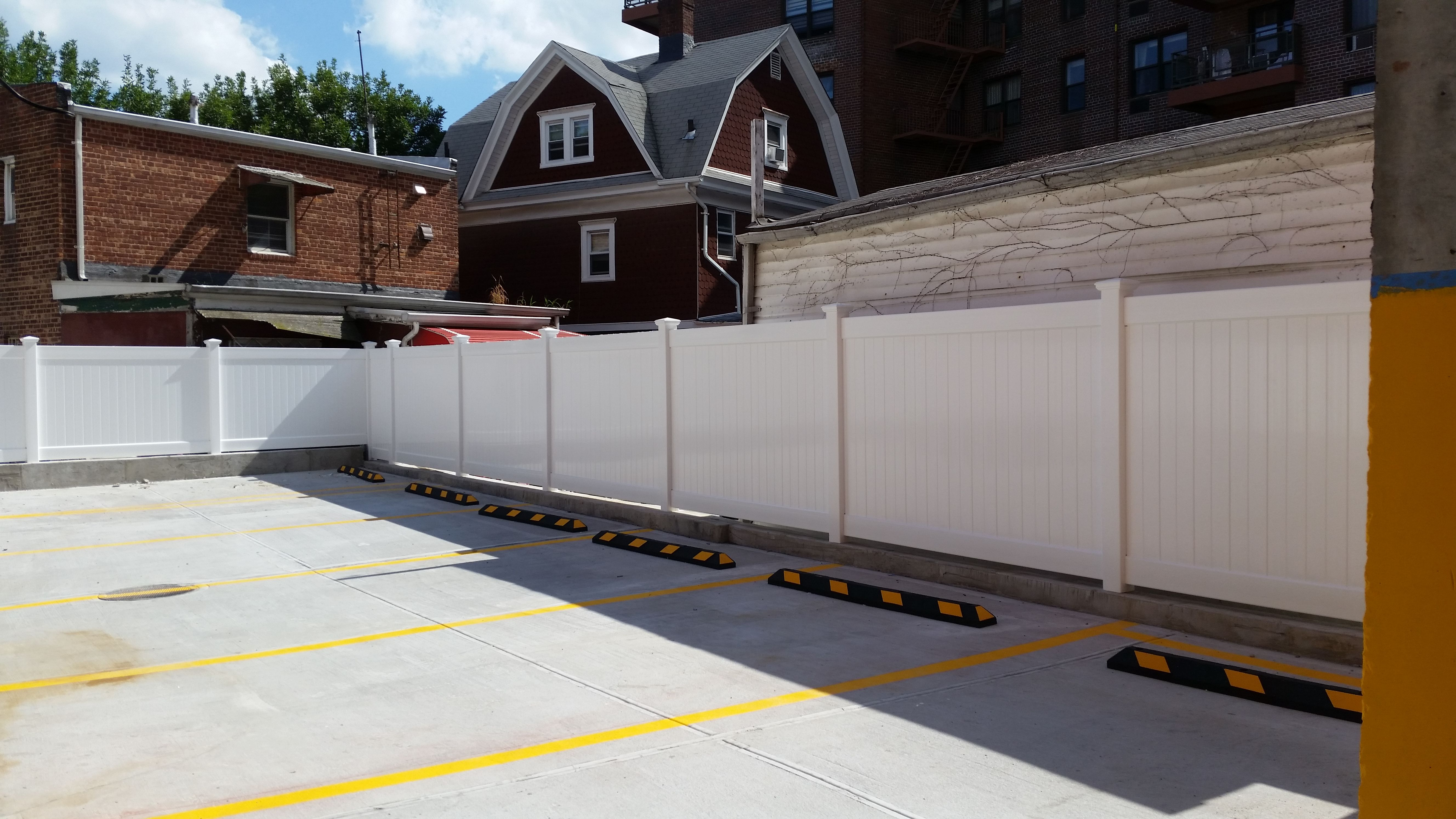 6 Infinity Solid Pvc Perimeter Fence Installed At A Ground Level Parking Garage In Elmhurst Queens Nyc By Liberty Fence Gates And Railings Fence Pool Fence